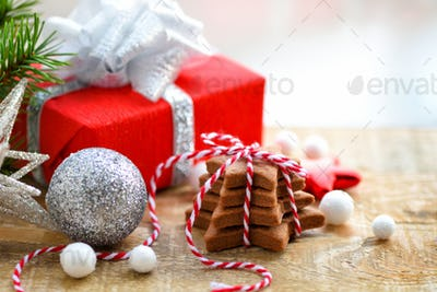 Christmas cookies with festive decorations on a wooden table. Ch