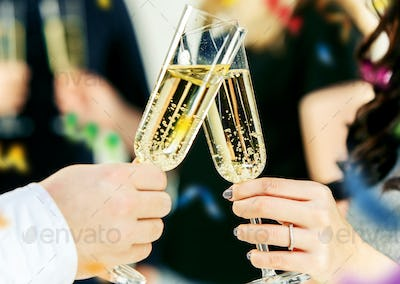 Celebration. Hands holding the glasses of champagne and wine making a toast.