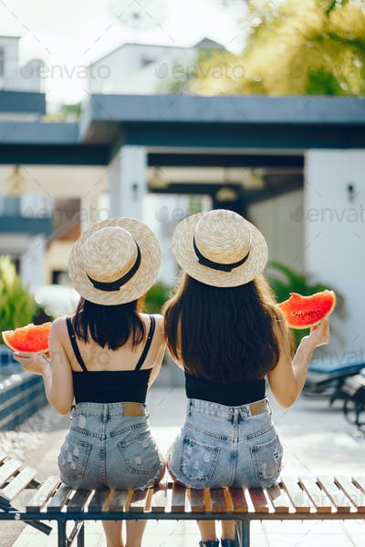 two girls eating watermelon
