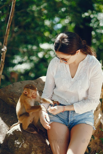 girl playing with monkey