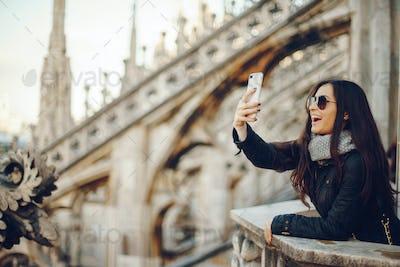 girl using her phone while exploring Milan Italy