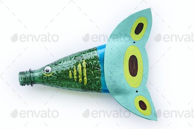 Plastic bottle recycled in a fish figure. Reuse garbage. Isolated