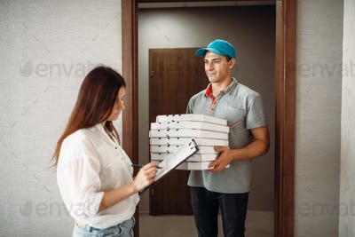 Pizza delivery boy takes a tip from customer