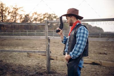 Cowboy with revolver, gunfight in gesert valley