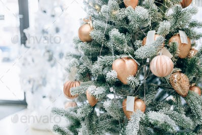 Christmas fir tree decorated with golden toys