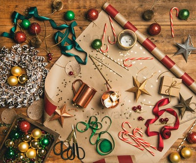 Hot chocolate and Christmas decoration over wooden background, top view