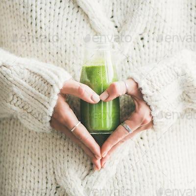 Winter seasonal smoothie drink detox in woman's hands, square crop