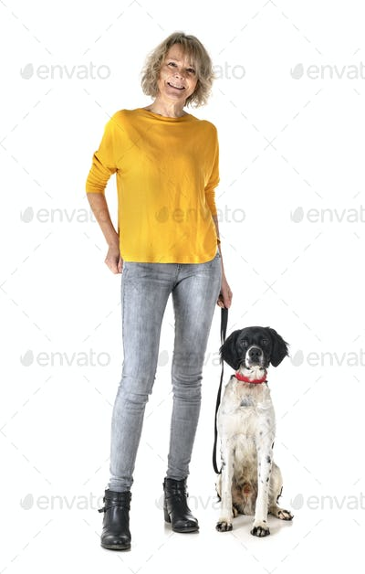 brittany dog and woman in studio