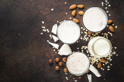 Vegan non dairy alternative milk, nuts and oat milk top view