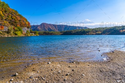 Beautiful landscape of mountain fuji with maple leaf tree around