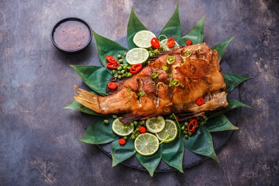 Deep fried fish with on bamboo leaves, copy space