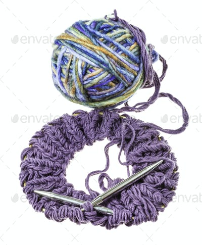 knitted snood with needles and ball of yarn