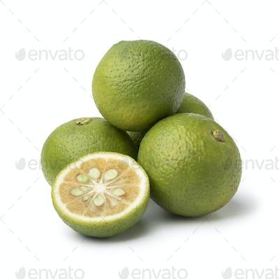 Fresh whole and halved  kabosu citrus fruit