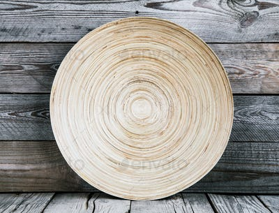 Empty wooden dish on the wooden background