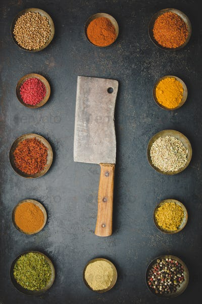 Various bowls of spices and meat knife