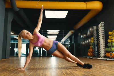 Young pretty woman working out with personal weight in a modern