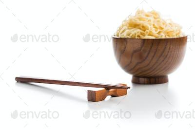 Wooden chopsticks and instant noodles.