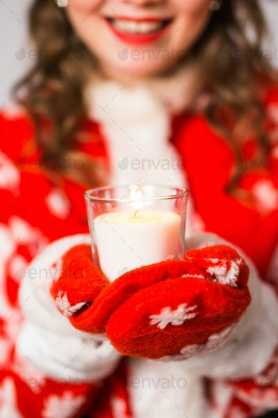 Christmas, celebration, people concept - Close up of Young charming woman in a Santa suit is holding