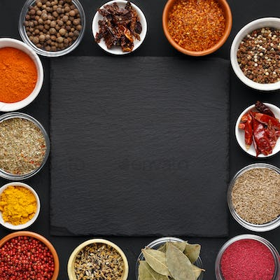 Assorted indian spices and herbs with space for text