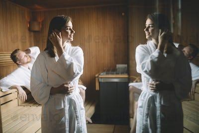 People enjoying sauna health benefits in spa