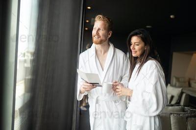 Happy young couple enjoying wellness spa resort treatments
