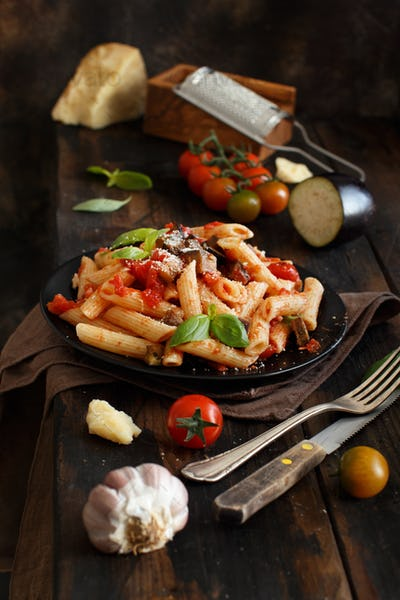 Penne alla norma  - traditional italian pasta with eggplants and tomatoes
