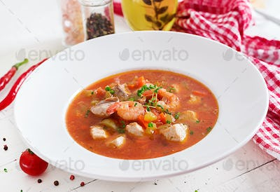 Brazilian food: Moqueca capixaba of fish and bell peppers in spicy coconut sauce