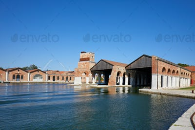 Venetian Arsenal with docks, canal and industrial buildings in Venice