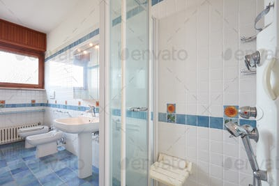 Normal bathroom with large shower in apartment interior