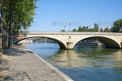 Paris, empty Seine river docks and bridge in a sunny summer day