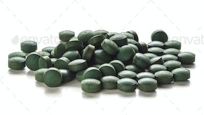 Spirulina Tablets Over White Background