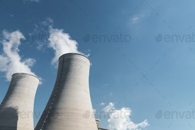 cooling tower closeup, power plant and blue sky background