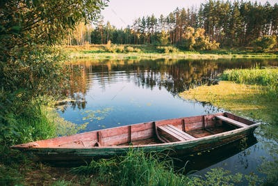 Old Wooden Rowing Fishing Boat Near Lake River Coast At Beautifu