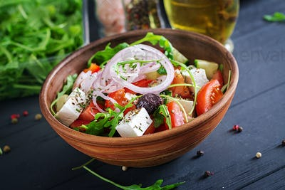 Greek salad with fresh tomato, cucumber, red onion, basil, feta cheese, black olives