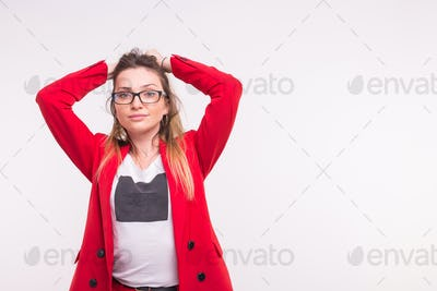 Beautiful young woman in red jacket and glasses