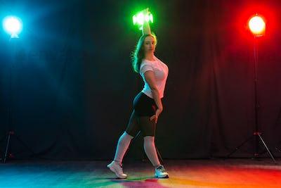 Hip-hop, jazz-funk, tecktonik, waacking, trance and street dances concept - Pretty woman dancing
