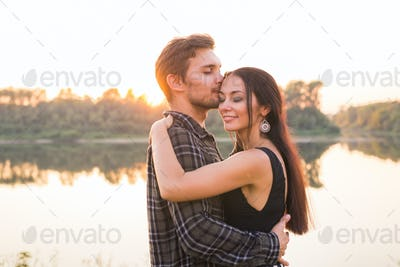 People, love and nature concept - Close up portrait of attractive woman and handsome man dancing on