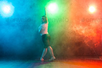 Hip-hop, jazz-funk, tecktonik, waacking, trance and street dances concept - Young woman dancing jazz