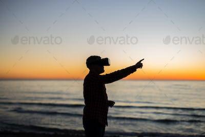 Man wearing virtual reality goggles. Dreams come true