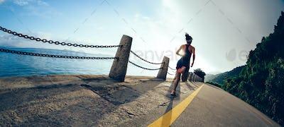 Running on beautiful sunrise seaside