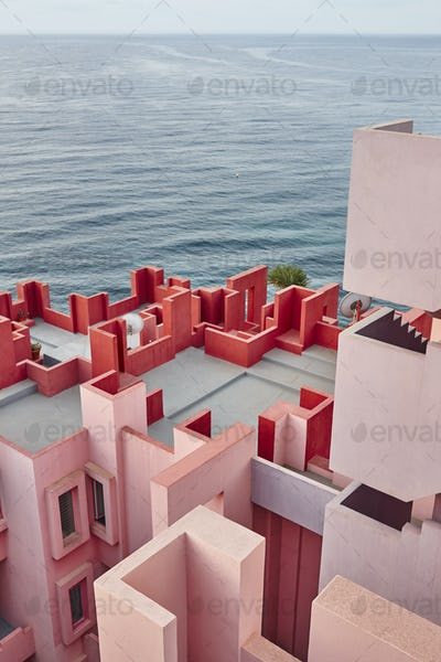 Geometric building construction. The red wall, La manzanera. Calpe, Spain
