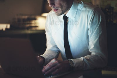 Close up of businessman working overtime