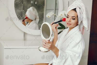 elegant woman in bathrobe