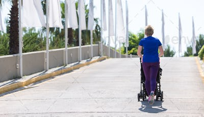 mom with baby stroller jogging