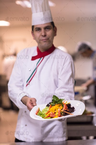 Chef showing a plate of tasty meal