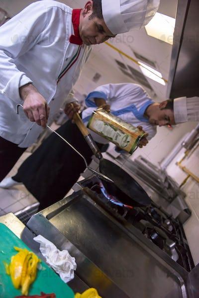 chef preparing food, frying in wok pan
