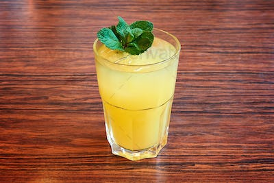 Fresh lemonade with mint leaves in glass
