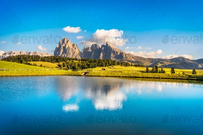 Lake and mountains, Alpe di Siusi or Seiser Alm, Dolomites Alps,
