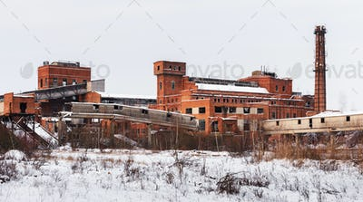 Old ruined factory construction in winter time