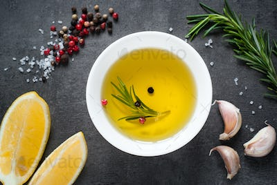 Black food background with olive oil and spices